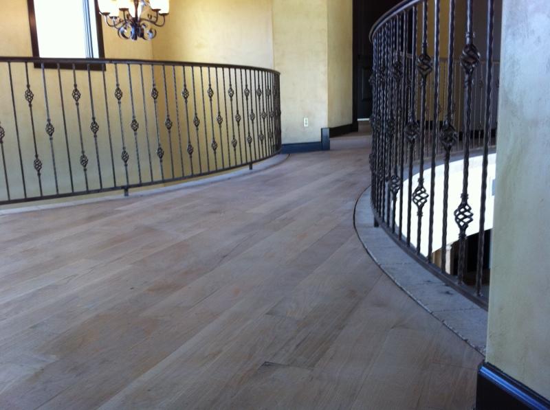 sanding wooden floorboards