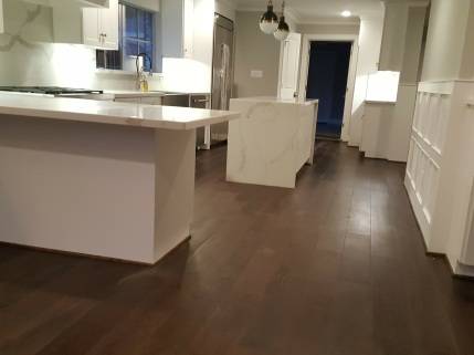 Kitchen wood flooring installation complete.